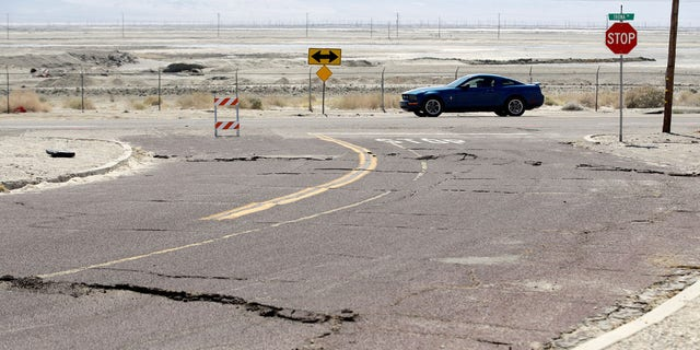 An earthquake-damaged street is seen Saturday, July 6, 2019, in Trona, Calif.