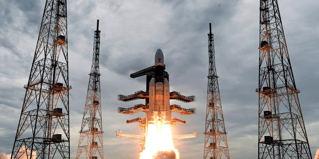 This photo released by the Indian Space Research Organization (ISRO) shows its Geosynchronous Satellite launch Vehicle (GSLV) MkIII carrying Chandrayaan-2 lift off from Satish Dhawan Space center in Sriharikota, India, Monday, July 22, 2019. India successfully launched an unmanned spacecraft to the far side of the moon on Monday, a week after aborting the mission due to a technical problem.