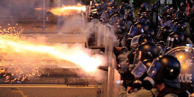 Hong Kong police fire tear gas at protesters in Sai Wan, Hong Kong on Sunday, July 28, 2019.