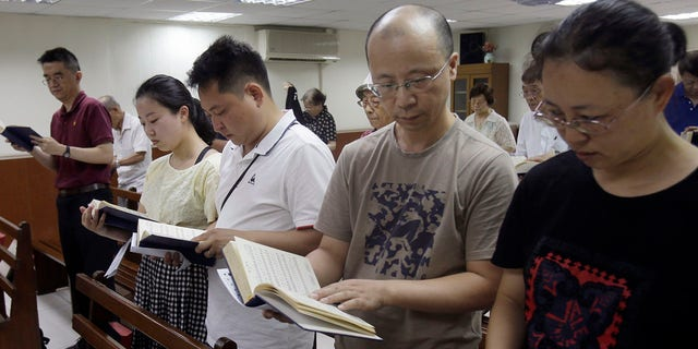 In this Sunday, Jul 7, 2019, photo, from right; Ren Dejun, Liao Qiang, Peng Ran and Ren Ruiting follow a strain book during use during a church in Taipei, Taiwan. The Sunday use this week during an artless church in Taiwan was generally relocating for one man, Liao Qiang. It was a initial time he had worshipped publicly given authorities tighten down his church in China 7 months ago. (AP Photo/Chiang Ying-ying)