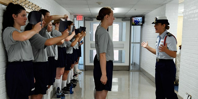 Yankee 2 company Cadre Mary Budri, right, puts female swabs through their paces during Day One of Swab Summer at the U.S. Coast Guard Academy Monday. (Sean D. Elliot/The Day via AP)