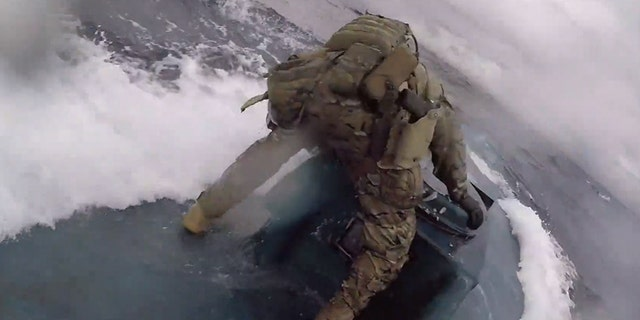 Dramatic video shows Coast Guard nabbing suspected drug-smuggling submarine