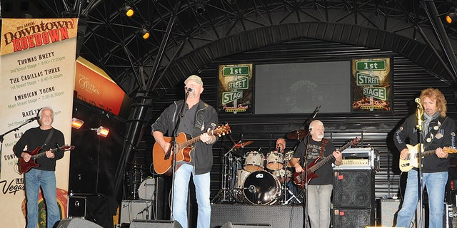 Rusty Hendrix, Danny Shirley, Mark Dufresne, Wayne Secrest and Bobby Randall of Confederate Railroad perform during a Fremont Street Experience during a 2014 Downtown Hoedown on Dec 3, 2014 in Las Vegas, Nevada. (Photo by Mindy Small/FilmMagic)