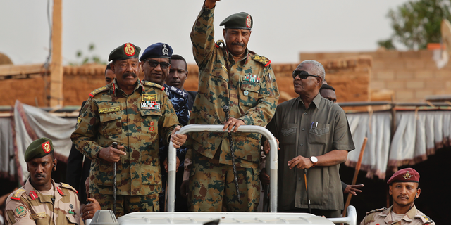 In this Saturday, June 29, 2019, file photo, Sudanese Gen. Abdel-Fattah Burhan, head of the military council, waves to his supporters upon his arrival to attend a military-backed rally in Omdurman district, west of Khartoum, Sudan.