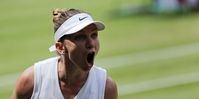 Romania's Simona Halep celebrates winning a point against Ukraine's Elina Svitolina in a Women's semifinal singles match on day ten of the Wimbledon Tennis Championships in London, Thursday, July 11, 2019. (AP Photo/Ben Curtis)