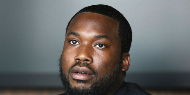In this Tuesday, July 23, 2019 photo, Meek Mill makes an announcement of the launch of Dream Chasers record label in joint venture with Roc Nation, at the Roc Nation headquarters in New York. A Pennsylvania appeals court has thrown out rapper Meek Mill's decade-old conviction in a drug and gun case. The unanimous three-judge opinion Wednesday grants the rapper born Robert Williams a new trial because of new evidence of alleged police corruption.