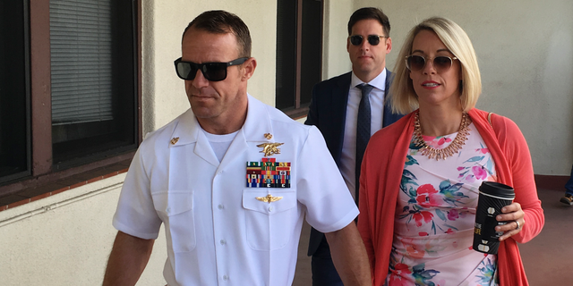 Navy Special Operations Chief Edward Gallagher, left, walking with his wife, Andrea Gallagher, this past Monday.