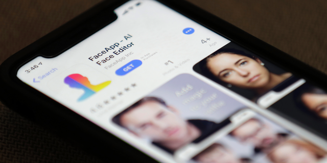 FaceApp is displayed on an iPhone Wednesday, July 17, 2019, in New York. (AP Photo/Jenny Kane)