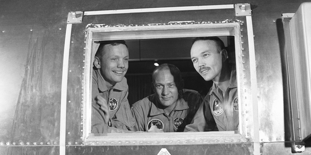 FILE - In this file photo, Apollo 11 crew members, from left, Neil Armstrong, Buzz Aldrin and Michael Collins sit in the MQF in Houston