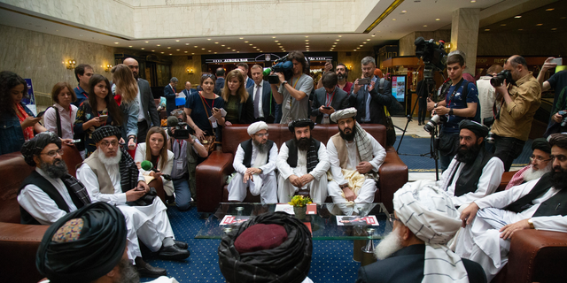 In this file photo taken on Tuesday, May 28, 2019, Mullah Abdul Ghani Baradar, the Taliban group's top political leader, left, Sher Mohammad Abbas Stanikzai, the Taliban's chief negotiator, second left, and other members of the Taliban delegation