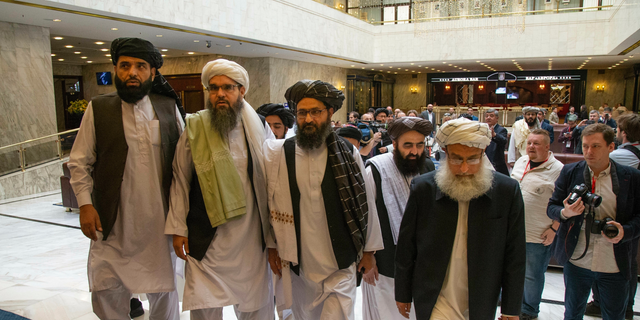 Mullah Abdul Ghani Baradar, the Taliban group's top political leader, third from left, arrives with other members of the Taliban delegation for talks in Moscow, Russia, in May 2019. (AP/Alexander Zemlianichenko, File)