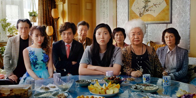"""This image released by A24 shows Awkwafina, center, in a scene from """"The Farewell."""" (A24 via AP)"""
