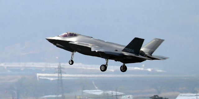 "In this March 29, 2019, photo, a U.S. F-35A fighter jet prepares to land at Chungju Air Base in Chungju, South Korea. The White House says Turkey can no longer be part of the American F-35 fighter jet program. In a written statement, the White House said Wednesday that Turkey's decision to buy the Russian S-400 air defense system ""renders its continued involvement with the F-35 impossible."" (Kang Jong-min/Newsis via AP)"