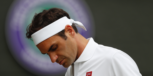 Roger Federer is dejected after losing a point to Serbia's Novak Djokovic during the men's singles final match of the Wimbledon Tennis Championships in London, Sunday, July 14, 2019. (Adrian Dennis/Pool Photo via AP)