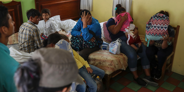 Central American migrants sit together inside a room at the Latino hotel during a raid by Mexican immigration agents in Veracruz, Mexico last month. Under increasing U.S. pressure to reduce the flow of hundreds of thousands of Central Americans through Mexican territory, Mexico's government has stepped up enforcement. (AP Photo/Felix Marquez)