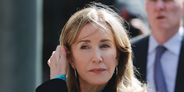 Actress Felicity Huffman arrives at federal court in Boston to face charges in a nationwide college admissions bribery scandal.