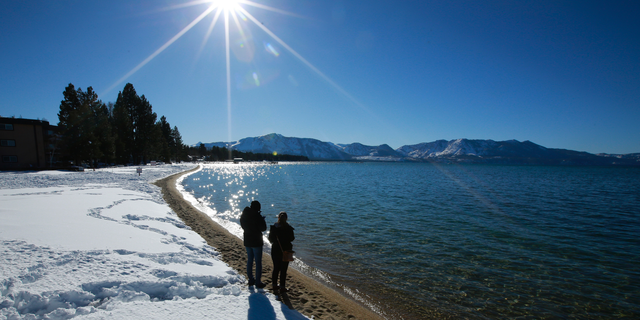 Lake Tahoe sits on the California-Nevada border and California's order doesn't apply to the Nevada side. (AP Photo/Rich Pedroncelli, File)