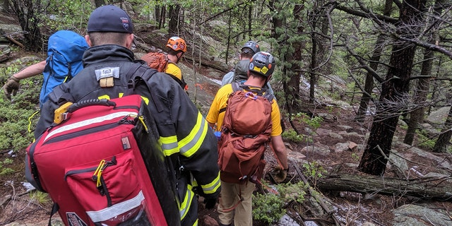 A woman told Colorado she was seeking shelter with a group of hikers when the lightning struck nearby.