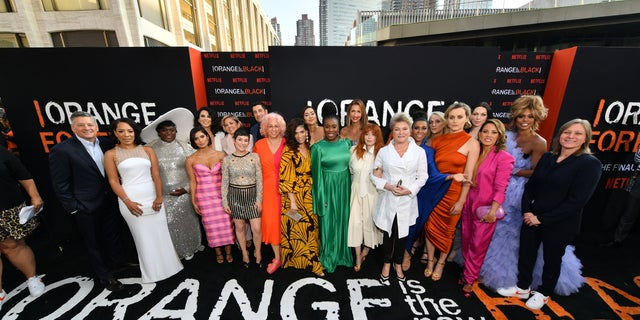 The cast including Selenis Leyva, Danielle Brooks, Diane Guerrero, Beth Dover, Jason Biggs, Jackie Cruz, Uzo Aduba, Alysia Reiner, Natasha Lyonne, Jessica Pimentel, Taylor Schilling, Laura Prepon, and Laverne Cox attend the 'Orange Is the New Black' Season 7 premiere in NYC on July 25.