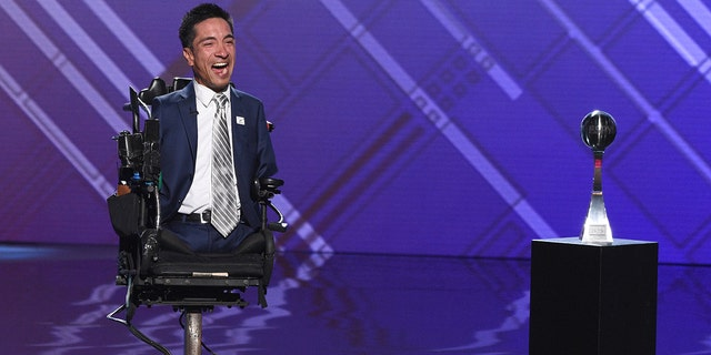 Rob Mendez, conduct manager of a youth varsity football group during Prospect High in Saratoga, Calif., accepts a Jimmy V endowment for stability during a ESPY Awards on Wednesday, Jul 10, 2019, during a Microsoft Theater in Los Angeles. (Photo by Chris Pizzello/Invision/AP)