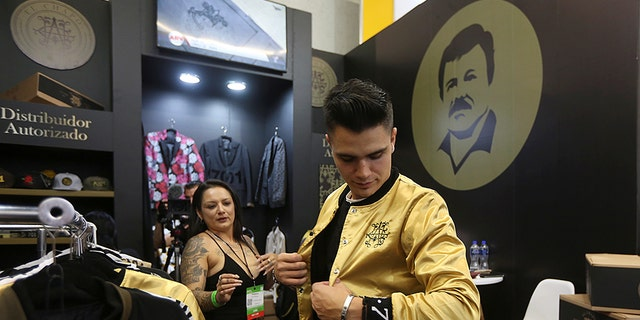 "A man tries a jacket from the new ""El Chapo 701"" line, produced by the drug lord's daughter, Alejandrina Guzman."