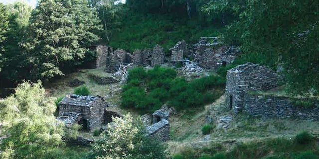 Stone houses, largely in ruins, in Monti Scìaga, a hamlet of the village Indemini. The local government is considering selling houses in Monti Scìaga for one Swiss franc each, an effort to bring people back to the area, which has been abandoned since the 1970s.