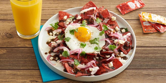 The Fire! Chip Chilaquiles with charred tomatillo salsa, Mexican crema, queso fresco, pico and a fried egg.