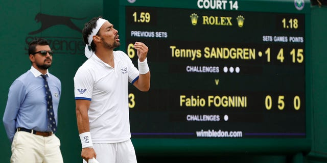 Italy's Fabio Fognini reacts as he plays United States' Tennys Sandgren in a Men's singles compare during day 6 of a Wimbledon Tennis Championships in London, Saturday, Jul 6, 2019.