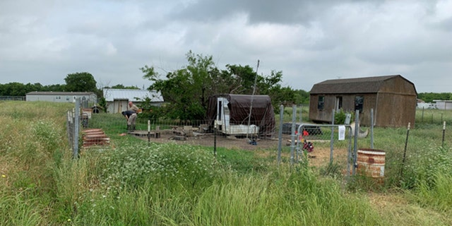 "Officials said there were 18 ""aggressive"" dogs living on the property. When the animals were seized, two of the dogs had been killed by other dogs."