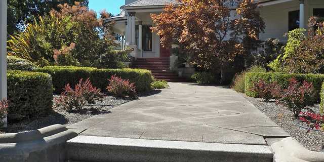 """Consider pressure-washing it at least once a month,"" an expert advises. ""It prevents wear and tear and quickly removes dirt to give your pathway a neat and clean look."""