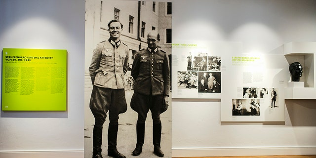 On this Friday, July 12, 2019, a picture of Claus Schenk Graf von Stauffenberg, left, and Albrecht Ritter Merz von Quirnheim is displayed at the exhibition at the German Resistance Memorial Center inside the Bendlerblock building of the defensive ministry in Berlin. Stauffenberg was one of the leaders of the failed assassination to Adolf Hitler one July 20, 1944. (AP Photo/Markus Schreiber)