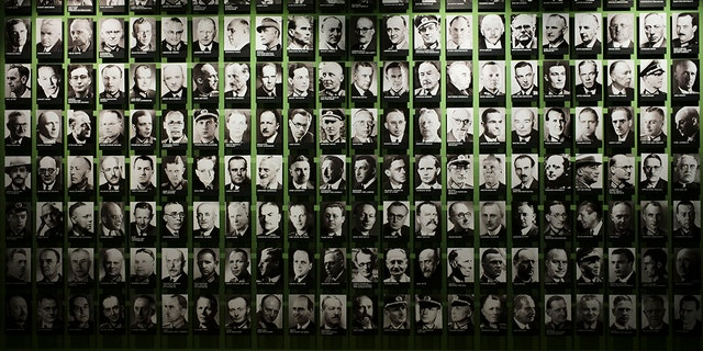 On this Friday, July 12, 2019 photo, pictures of co-conspirators of the failed July 20, 1944 attempt to assassinate Adolf Hitler are displayed at the exhibition of the German Resistance Memorial Center inside the Bendlerblock building a part of the German defensive ministry in Berlin. (AP Photo/Markus Schreiber)