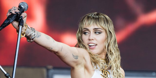 Miley Cyrus Channels Britney Spears in New Music Video