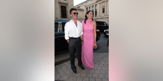 Simon Cowell and Lauren Silverman seen attending Syco - summer party at Victoria and Albert Museum in London.