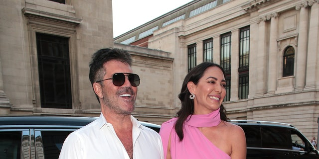 Simon Cowell and Lauren Silverman seen attending Syco - summer celebration during Victoria and Albert Museum in London.
