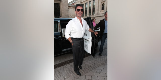 Simon Cowell seen attending Syco - summer party at Victoria and Albert Museum on July 4.