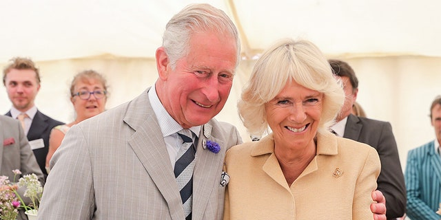 Camilla, Duchess of Cornwall is sung Happy Birthday by Prince Charles, Prince of Wales and the crowds gathered at the National Parks 'Big Picnic' celebration in honor of all 15 of the UK's National Parks, during an official visit to Devon & Cornwall on July 17, 2019, in Simonsbath, England. Held in Exmoor National Park the picnic marks 70 years since they were created by the 1949 National Parks and Access to the Countryside Act.
