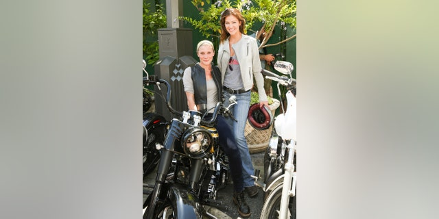 Katee Sackhoff (L) and Tricia Helfer (R) attend the 4th annual Kiehl's LifeRide for amfAR at The Grove on August 8, 2013, in Los Angeles, California. (Photo by Paul Archuleta/FilmMagic)