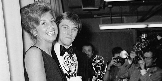 Michael Learned and Richard Thomas each hold their Emmy Awards for Outstanding Continued Performance in a Leading Role, Hollywood, Calif., May 20, 1973. (Photo by Max Miller/Fotos International/Getty Images)