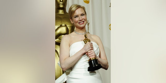 Renee Zellweger poses with her Oscar for Best Supporting Actress on Feb. 29, 2004, in Hollywood, Calif. (Photo by Frederick M. Brown/Getty Images)