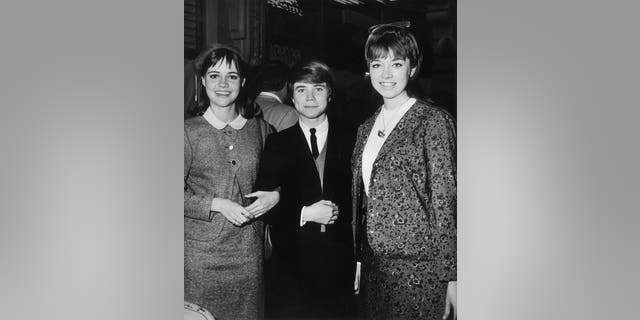 American actors Sally Field, Jon Provost and Angela Cartwright smile while attending an event circa 1965. (Photo by Jack Knox/Hulton Archive/Getty Images)