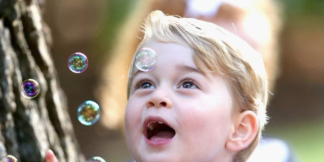 Prince George of Cambridge plays with bubbles at a children's party for Military families during the Royal Tour of Canada on Sept. 29, 2016 in Victoria, Canada.