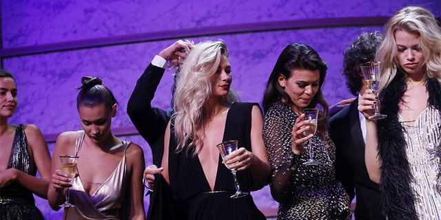 (L-R) Bella Hadid, Jessica Hart, Georgia Fowler and Hailey Clauson on stage at the amfAR Gala Cannes 2017 at Hotel du Cap-Eden-Roc on May 25, 2017 in Cap d'Antibes, France. (Photo by Chris Jackson/French Select for amfAR )