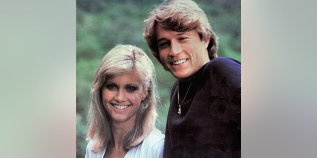 Andy Gibb with Olivia Newton-John. (Photo by GAB Archive/Redferns)