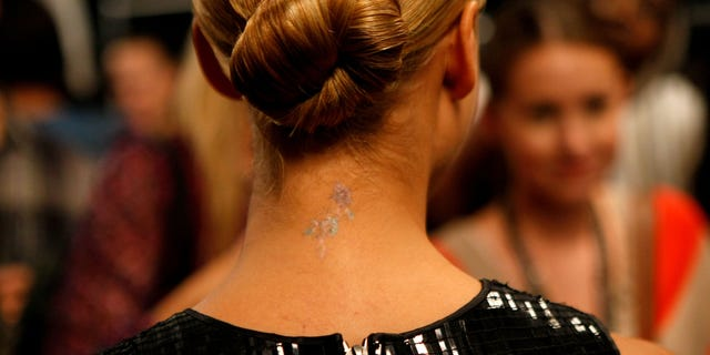 Jessica Alba's neck tattoo in 2010.(Photo by Michael Buckner/Getty Images for Mercedes-Benz)