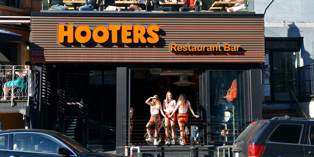The line includes eight different spirits, including a corn-based Hooters Vodka, Hooters Gin, a Hooters Light Rum and a Hooters Dark Rum.