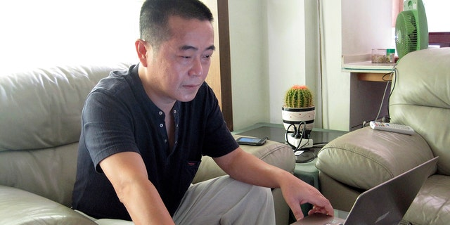 China's first 'cyber-dissident' given 12-year jail term: court