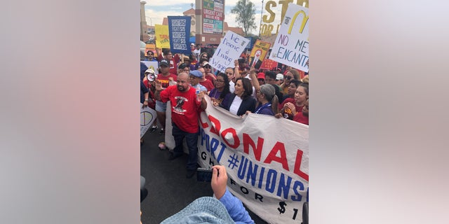 Presidential candidate Kamala Harris marches with McDonald's workers protesting for a $15 minimum wage in Las Vegas.