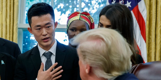 President Trump listens to Ilyong Ju, a Christian from North Korea, as he meets with survivors of religious persecution in the Oval Office of the White House on Wednesday, July 17, 2019, in Washington. (AP Photo/Alex Brandon)