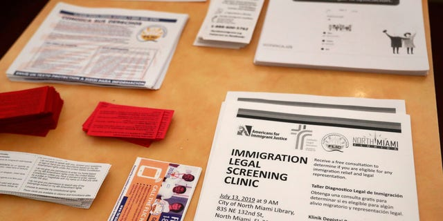 Flyers in English and Spanish are shown stacked at a nearby restaurant before immigration advocates gather them and hand them out, Thursday, July 11, 2019, in the Little Havana neighborhood in Miami.
